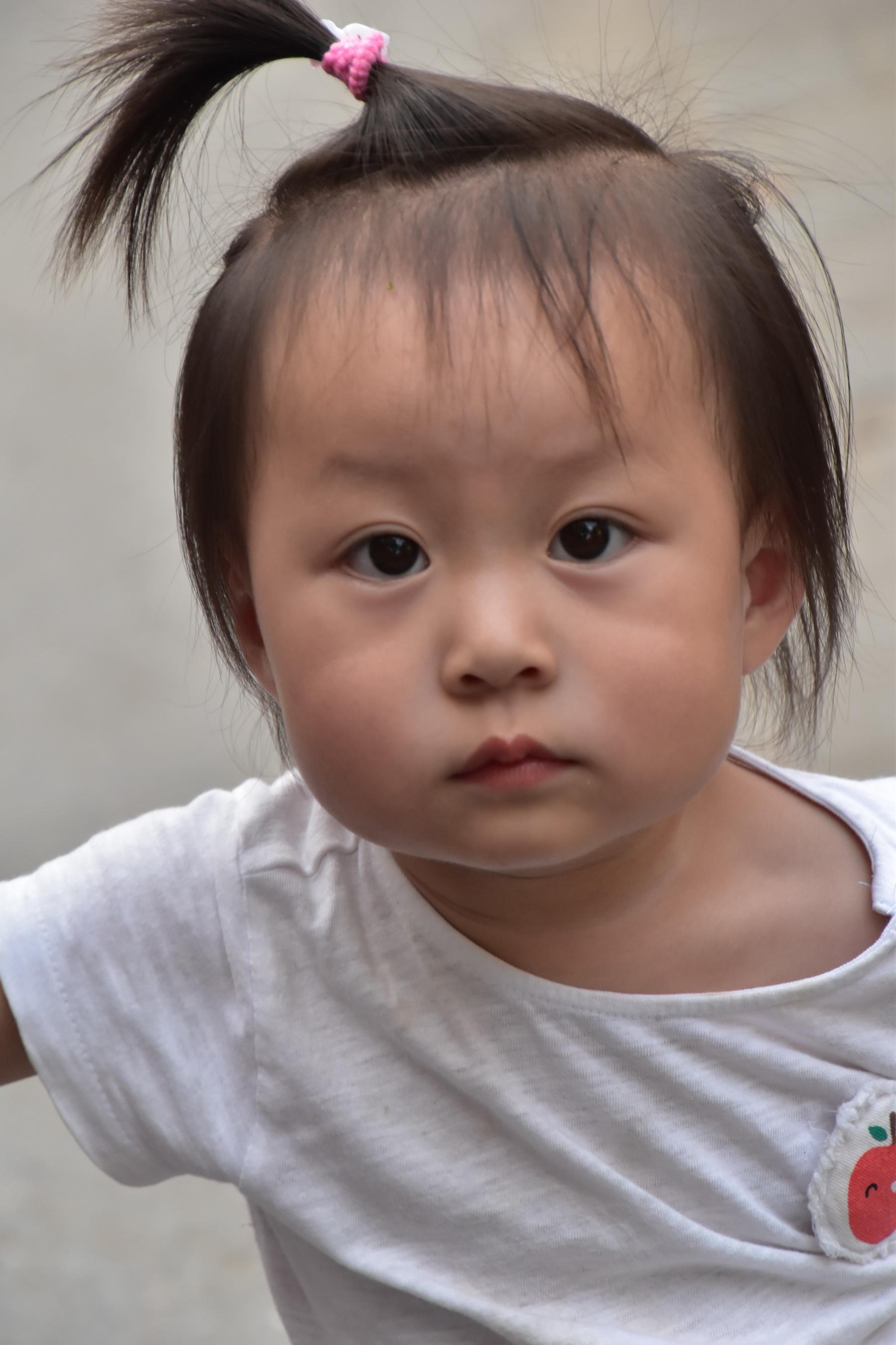 סין - תינוקת עם ציצית